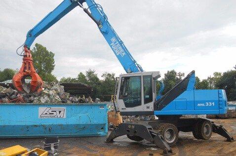 Crane moving scrap metal