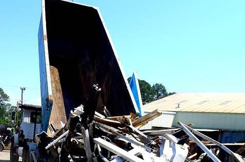 Truck dumping scrap metal
